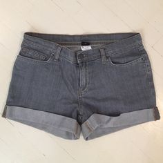 Gray cuffed denim shorts Mid-rise, 4 inch inseam gray denim shorts with button back pockets. Very comfortable shorts with a bit more coverage, more athletic styling. Very nice, barely worn. Patagonia Shorts Jean Shorts