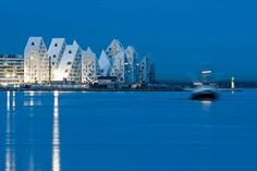 """Iceberg, Housing Complex, JDS Architects, 2012. In the new Aarhus Docklands development area, this housing complex features a curious topography, with a series of """"peaks"""" and """"canyons"""" ensuring that all apartments are supplied with a generous amount of natural lighting and waterfront views."""