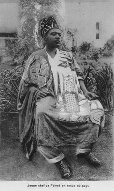 Africa | Young Chief of Fokwe, in national dress. Cameroon || Scanned vintage postcard
