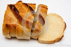 Slices of white bread, even cut. Bread made of white wheat contains gluten. The crust is over cooked.