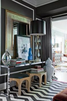 David Jimenez I love this sophisticated and elegant layered space by David Jimenez. It is a masculine approach with charcoal walls and drapes, a black and white zigzag rug, an oversized ginger jar, an