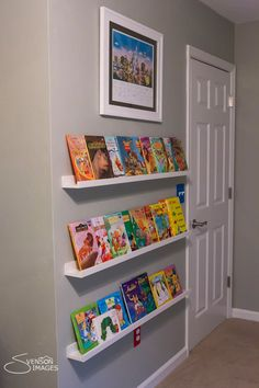 bookshelf- ikea ribba Such a cute way to fill up an empty wall, and it is like it's own artwork as well!!!