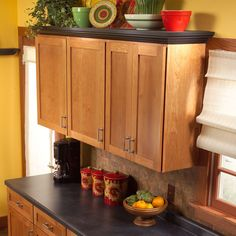 How to Add Shelves Above Kitchen Cabinets  Great idea for flat top shelf above kitchen cabinets.  Adds a little more character too.  http://www.familyhandyman.com/DIY-Projects/Home-Organization/Kitchen-Storage/how-to-add-shelves-above-kitchen-cabinets/Step-By-Step