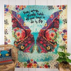 """""""Your Wings"""" Tapestry - Tapestries are so fun and versatile!! This tapestry features a colorful butterfly graphic with a watercolor flower border and the sentiment, """"Your wings already exist… all you have to do is fly"""". The finished edge makes it perfect for walls, beds or picnic and beach days!"""