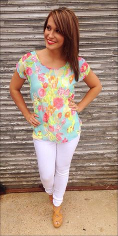 Bright flowered top! Call 678-588-9401 to order!