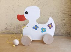 Wooden pull & push toy Duck in white handmade wooden toys for