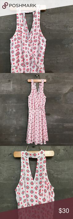 Lush • Faux Wrap Dress A white dress with a pretty flower pattern all over -- the colors of the flower are two different shades of neon pink and then dark gray around the bright flowers. The front is a v-neck and he back has a fun drapey cut-out. So much more colorful in person! Lush Dresses Mini