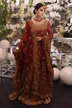 This extravagant bridal outfit is one of our best pieces. Its bespoke and has luxe zardoze work in gold reshum, zarri, dubka, stones and sequins. It has a heavily worked back as well with a dori tassel on the back neckline. It is paired with a rich zardoze worked dupatta with extremely heavy worked pallus and borders. The outfit is completed with a two-toned farshi that too has intricate embroidery and booti chan all over.