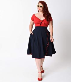 Time to throw yourself a parade, dames! The plus size high waist Parade skirt features contrast colored piping in a swank scalloped shape down the front and piping along the bottom of the stylish skirt, with matching button details. Best part, this skirt