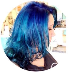 More amazing color coming from the talented team at Head Candy! How about this gorgeous dimensional bright blue mermaid hair?!  Kristin painted on a combo of custom mixed blues to create this beauty! #salonheadcandy #bluehair #modernsalon #americansalon #lpweeklydo #mermaidhair #dyeddollies #btcpics #brighthair #unicorntribe