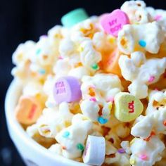 So easy! White chocolate popcorn with valentine sprinkles...candy hearts are optional
