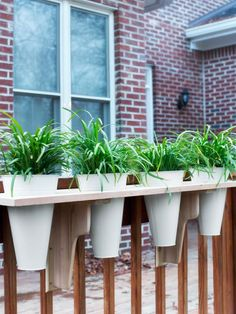 Dress up your windows or deck railing with planter pots placed into planks of pressure-treated pine.
