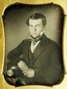 """Photographer or enthusiast  Daguerreotype, 1/4 plate  circa 1850s    note the tall collar, standing above the chin line and the large cravat... on a younger gent, this says """"1850s"""""""