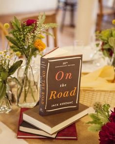 Marking The Tables • Kalista and Kyle used copies of their favorite books in lieu of table numbers.  Photo by Sequins and Candy   Photo via Project Wedding