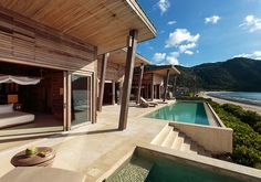 Six Senses Con Dao, Vietnam / No shirt, no shoes, no problem could be the daily mantra at this Six Senses haven constructed from reclaimed teak, including over a thousand recycled antique wooden panels (above). Sustainability takes center stage, with initiatives including local and organic meals, no plastic water bottles, and nontoxic biodegradable cleaning products and amenities.