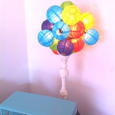 I used this string of mini-Chinese lantern lights to make a new lamp. I bunched the string of lights up into a big ball and affixed it to an old lamp base that I painted creamy white.