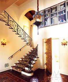 The wrought-iron banister, the arch, the wood ceiling, the chandelier: California style is beautiful.
