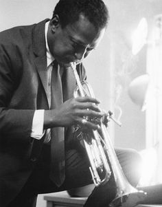 Miles DavisAmerican jazz musician, bandleader and composer Miles Davis playing the trumpet in a dressing room before a performance