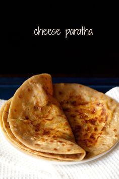 cheese paratha recipe with step by step photos. easy to prepare delicious cheese parathas with a spiced cheese stuffing.
