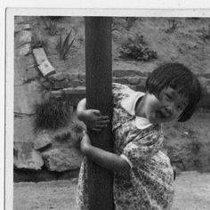 Smiling girl holding onto a pole, Korea, June 1947 :: International Mission Photography Archive, ca.1860-ca.1960