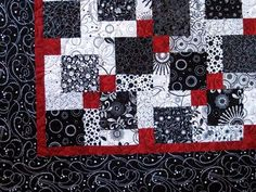 Disappearing 9-Patch - I love the contrasting red, black & white. I keep telling myself that I am going to make one of these one day... maybe it will happen.