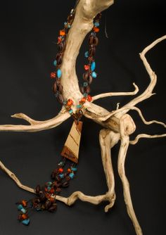 collar largo tejido en cuero con semillas,tagua,piedras semipreciosas,algunos detalles en acrilicos .Tonalidades  azul turquesa/naranja/café. Piezas exclusiva Coleccion 2005