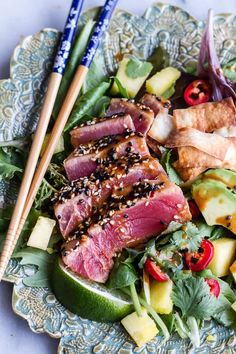 Seared tuna on a spring green, pineapple, cilantro salad with wonton crisps