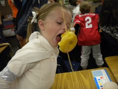 Donut on a String: Last year, we hung a donut on a string from every single desk in the second grade classroom. At the signal, it was the funniest donut eating competition I've ever seen. A classic.