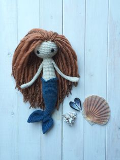 Miriam the Mermaid is made from a mixture of wool and acrylic yarns, polyester fibrefill, and Magic. She has swam twice around the world and is