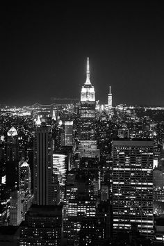 Night Empire. Photography, Skyline, NY, New York City, Art, Print, Decor, Manhattan, Urban, Classic, Empire State Building. Sizes Available from 5x7 to 20x30. The beautiful NY skyline at night in Black and White featuring the Empire State Building and the Freedom Tower in the background***.Photo comes un-matted and un-framed. Photos are shown in a room setting and are for size comparison. Last photo is a size comparison chart, is not the photo you are purchasing. Depending on the size you...