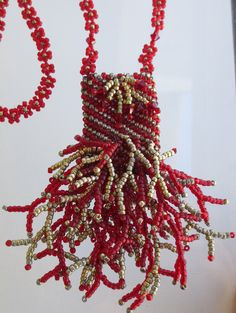 Beaded Amulet Bag with Red & Gold Seed Beads and Crystals Handmade in Peyote Stitch, Branch Fringe and Daisy Chain by AbigailKatz on Etsy https://www.etsy.com/listing/112239845/beaded-amulet-bag-with-red-gold-seed