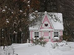 Adorable pink guesthouse in the snow