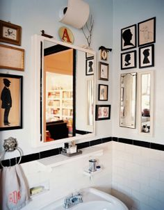oh yes. usually bathrooms are so boring but a bunch of family pics might make it fun