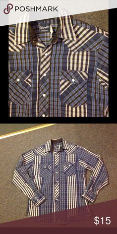 "Vtg Wrangler Blue Plaid Flannel Pearl Snap Shirt Nice vintage Wrangler flannel shirt. Pearl snap. Nice condition. Would best fit a Medium. My husband wears a Large and it's a little snug. Chest 44"" Length 27"" Sleeves 35"" Vintage Shirts"