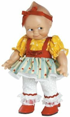 """Kewpie Salt Water Taffy Doll by Charisma. $29.99. Inspired by Rose O'Neill's original drawings. Edition size open. Open edition. Celebrating over 100 years of doll making. 8"""" full vinyl. From the Manufacturer                Kewpie is truly a collectible figure inspired by Rose O'Neill's original drawings. """"Kewpie Salt Water Taffy"""" arrives wearing a bright yellow top, a striped skirt with red hearts printed on it and red straps. A red ribbon headband, white pants with red tr..."""
