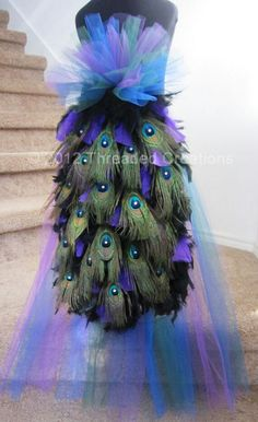 This seems easy to make. Regular looped purple, teal. and blue long in the back tutu w peacock feathers attached. I would do the front to thigh and full.
