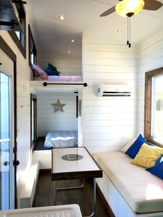 Harmony Tiny Homes-Youngstown. I like the bunked style beds/rooms with hanging storage. And the old sink just like our home now.