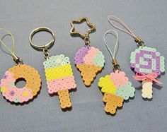 These pretty little Perler Bead accessories are simply sweet! Choose your favorite one, or collect all five! Then choose either circle or star key rings, phone strap charms, magnets, or ornaments. by RainbowMoonShop on Etsy Perler Bead Designs, Easy Perler Bead Patterns, Melty Bead Patterns, Perler Bead Templates, Hama Beads Design, Diy Perler Beads, Perler Bead Art, Pearler Beads, Fuse Beads