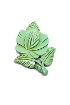 Mint Flower Carved Brooch.  Mint, I believe was not a bakelite color.  However I suspect it's carved deeply bakelight was,However it might be catalin or galalith.