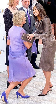the rules of curtseying. Also, I just love any pic of that horrible woman curtseying to Diana's daughter in law.