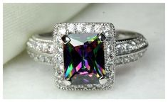 5-9 CZ RAINBOW MYSTIC TOPAZ W ACCENTS RING is going up for auction at  8am Mon, May 13 with a starting bid of $1.
