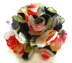 Large acrylic black and coral floral rose pendant measuring 56 x 56mm.  These pendants have two holes drilled in the edges of the petals so that they can be suspended by either wire or chain #beads #acrylicbeads #vintage