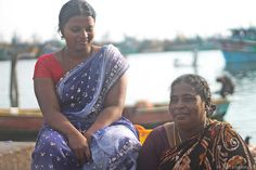 Mother and Daughter Kasimedu Fishing harbour - Mother and Daughter at Kasimedu Fishing harbour, (Royapuram, Chennai) retail fish market keep…
