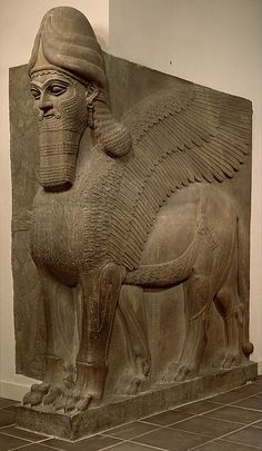 Assyrian Human Headed Winged Bull. Gypsum Alabaster. H. 313.7 cm. Neo-Assyrian Period. 883-859 BCE. Nimrud (ancient Kalhu), Iraq. Metropolitan Museum of Art: 32.143.1–.2.