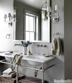 A washstand with towel bars saves space in small #bathrooms. #decorating (Photo by: Jonny Valiant/House Beautiful)