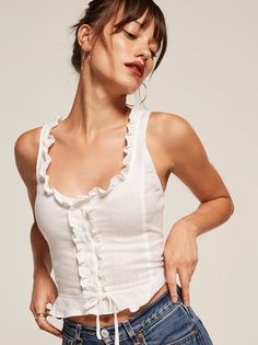 Casual corsets. This is a tight fitting, ruffle edged top with center front buttons and a tie.