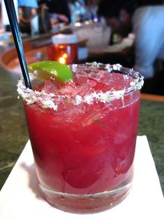 Bing Cherry Margarita (follow link) OR 1.5 oz Cherry Vodka, .5 oz Triple Sec, 1 oz Lime Juice, Splash Grenadine, Lime Circles for garnish. Blend ingredients with two cups of ice. Pour in sugar rimmed glass. Garnish with lime circles.