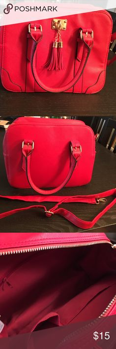 EUC red purse Beautiful red faux leather purse with zipper closure and long detachable strap. Inside has one zip pocket, two open pockets, and lots of space! Purchased in Ireland. Kept in a smoke free home but worn by a smoker. New Look Bags Shoulder Bags