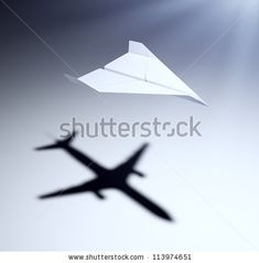 Paper airplane casting a shadow of a jetliner - vision and aspirations concept illustration by Mopic, via Shutterstock