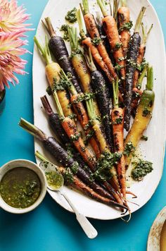 Charred Carrots with Basil and Mint - a fall side dish that is equally as addictive as candy! Get the recipe from www.whatsgabycooking.com (@whatsgabycookin)